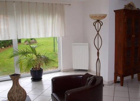 radiateur électrique vertical Aterno dans un salon